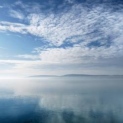 Пазл онлайн: Облака над морем