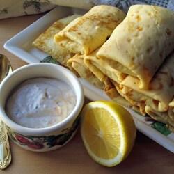 Пазл онлайн: Блинчики с картофелем под соусом из сельди