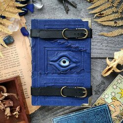 Пазл онлайн: Синий простроченный журнал путешественника