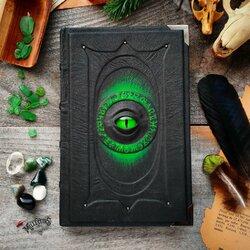 Пазл онлайн: Тёмная книга с зелёным сиянием