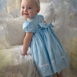 Пазл онлайн: Малышка в голубом