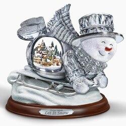 Пазл онлайн: Снеговик на санках