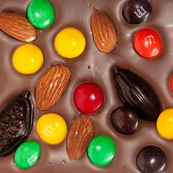 Пазл онлайн: Конфеты в шоколаде